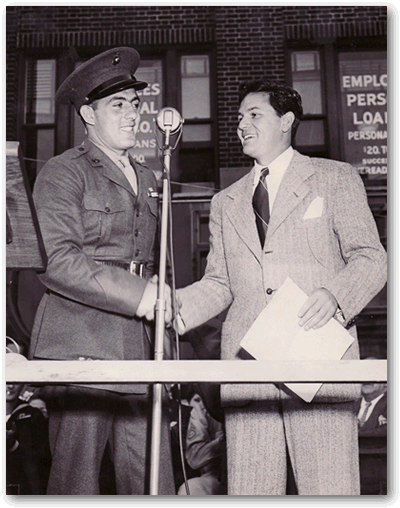 John Basilone on podium with actor John Garfield.